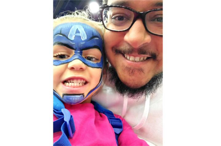 UKHC patient Demetrius Booker smiles with his daughter.