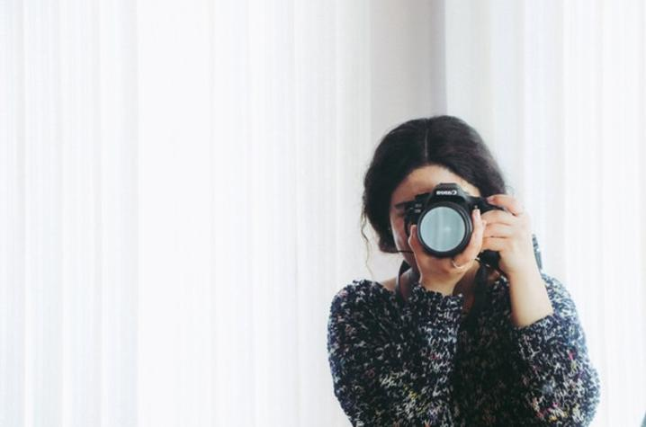 Woman taking a picture.