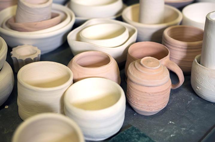 photo of ceramic bowls, mugs, vases