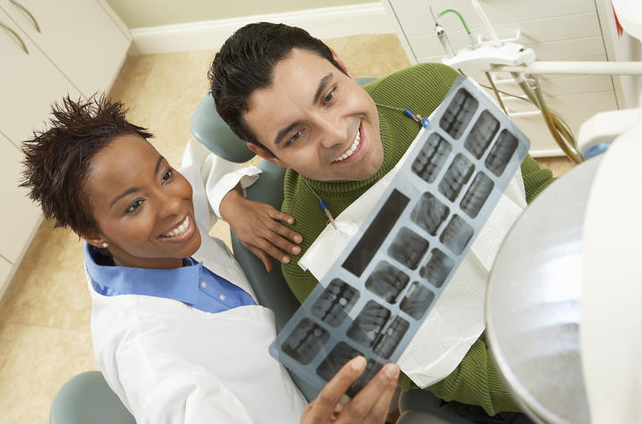 photo of dentist and patient