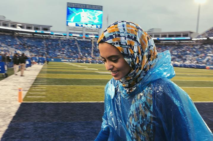 photo of Hadeel Abdallah at Kroger Field after game recognition
