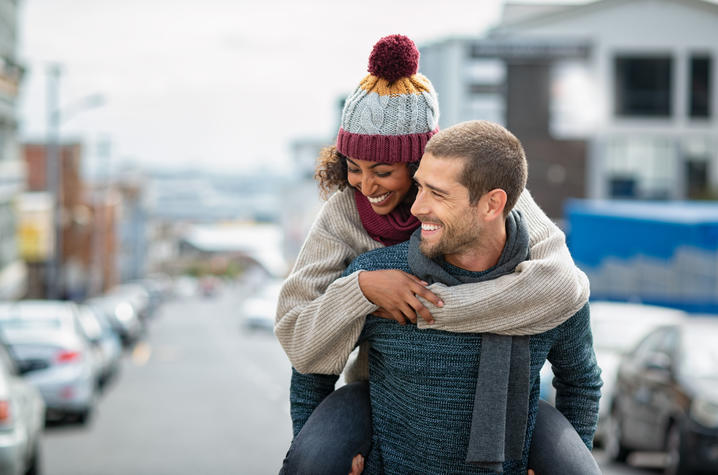 Couple in sweaters and hat
