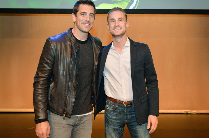 This is a photo of Green Bay Packers QB Aaron Rodgers (L) with Ed Berry (R).