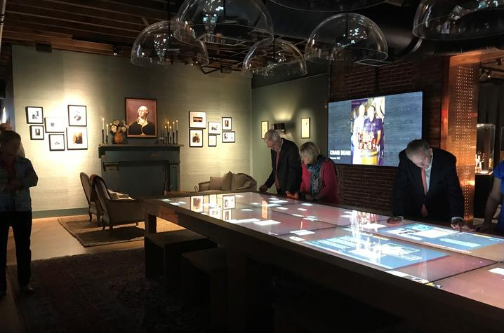 photo of people using interactive table in Gracious room of Kentucky Bourbon Trail Welcome Center