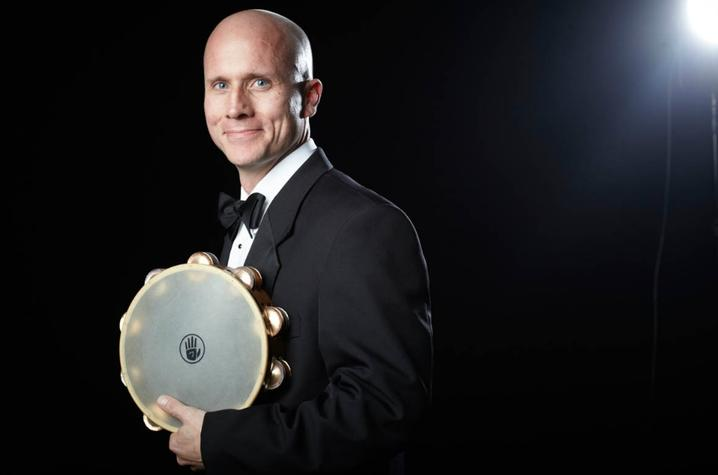photo of Joshua D. Smith with tambourine
