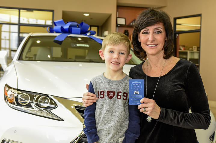 Brady Creemens with Lexus winner Eileen Potter.