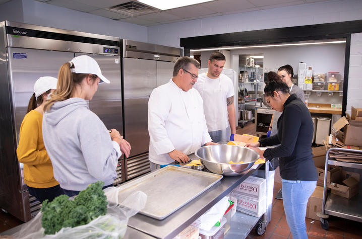Chef Bob Perry instructs students in Erikson Hall kitchen