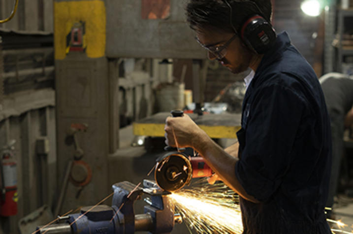 photo of male student in metalworking class