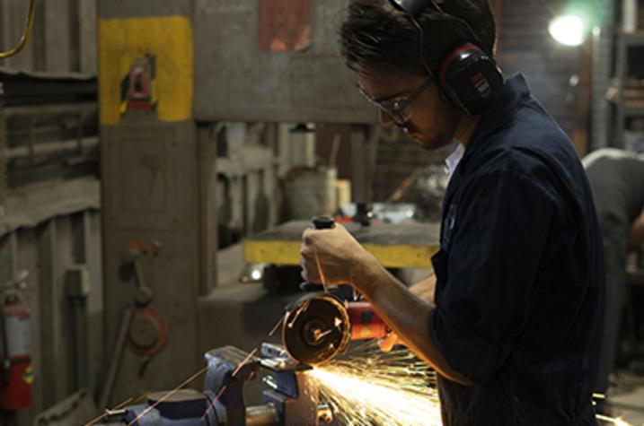 photo of man working in metalworking class