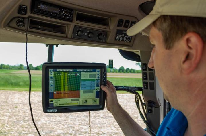 """Chad Lee, director of the UK Grain and Forage Center of Excellence, monitors the planting progress of the """"Sacred Acre"""" of corn at UK. Photo by Ginny Gregory, Kentucky Distillers' Association"""