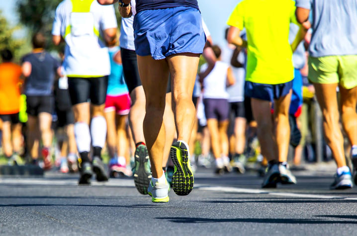 photo of people running and walking