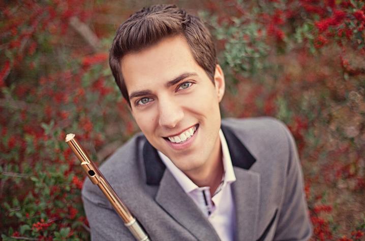 headshot photo of Seth Morris outside with flute
