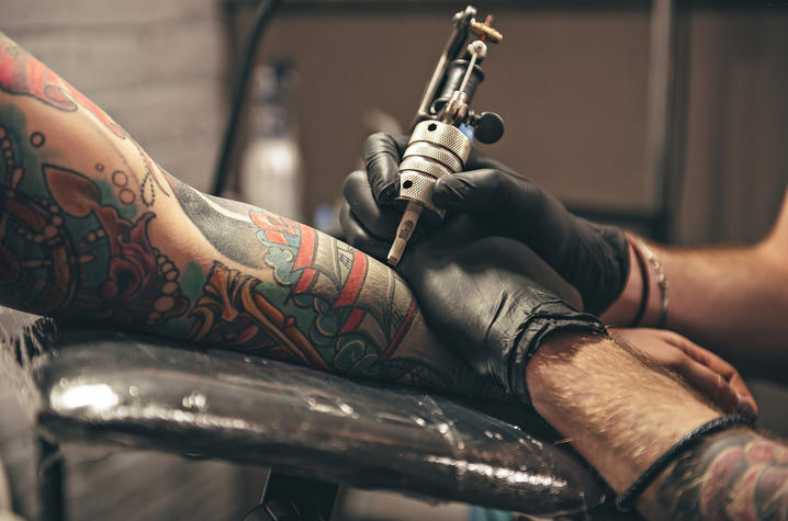 A new study finds that tattooed skin does not sweat as much as non-inked areas of the body | Photo from Getty Images.