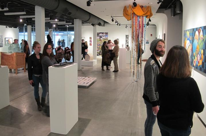 photo of visitors at Carey Ellis Juried Show at Open Studio