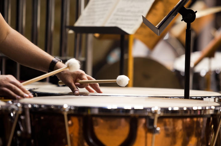 photo of hands playing timpani
