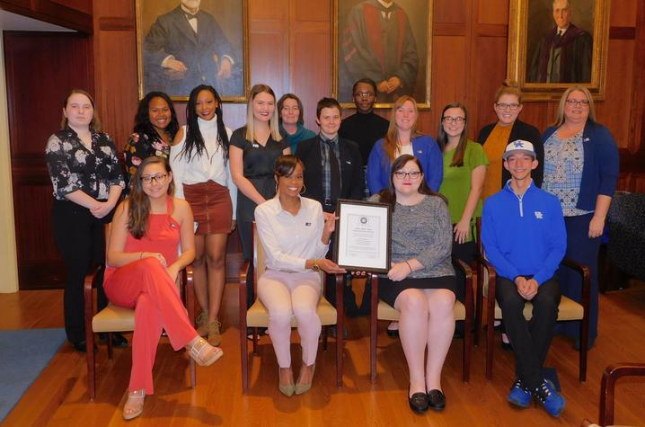 Photo of several students inducted into Alpha Alpha Alpha honor society