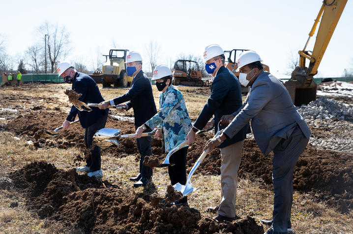 photo of groundbreaking with Woodbury on building and lab at Coldstream Research Campus