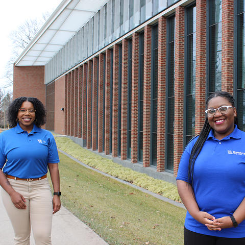 Shantale Davis and Ashlei McPherson, both first-year law students, pictures in front of the J. David Rosenberg College of Law