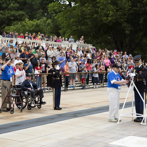A photo of UK Honor Flight veterans at a wreath laying ceremony