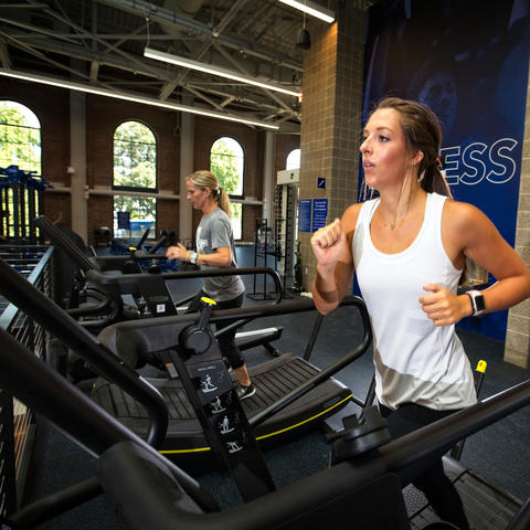 photo of women on treadmills - Alumni Gym