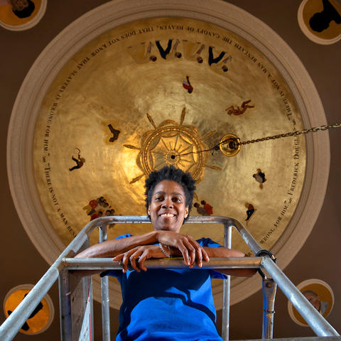"photo of Karyn Olivier under ""Witness"" in Memorial Hall"
