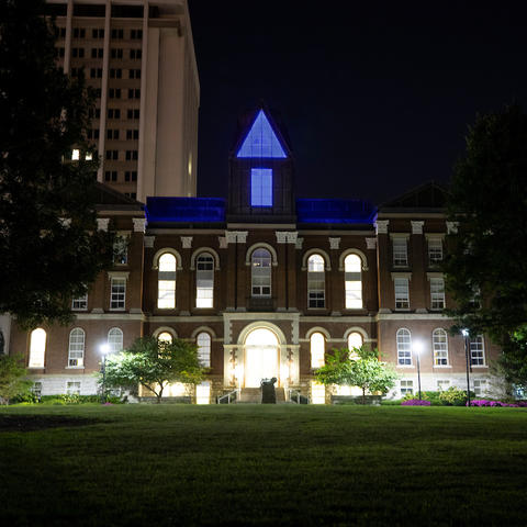 photo of Main Building lit in blue