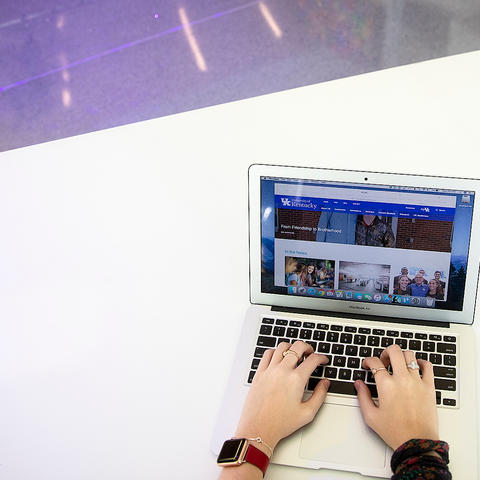 photo of someone using laptop