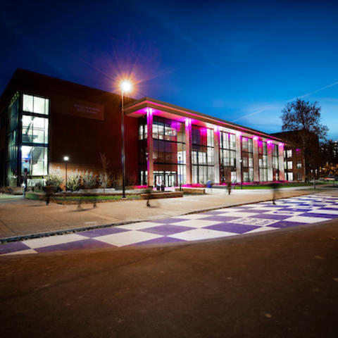Purple lights shining in the Jacobs Science Building.