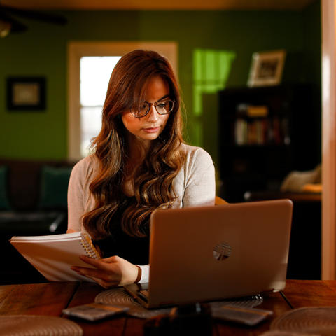 Photo of woman using a computer.