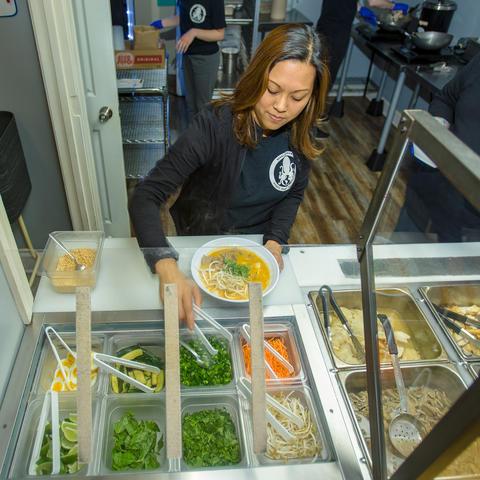 Mae Suramek dishes out noodles in her Berea restaurant, Noodle Nirvana