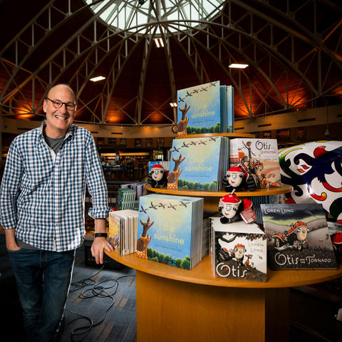 Loren Long with display of his children's books at Joseph-Beth Bookseller