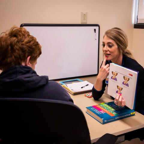 Speech-language pathologist Corie Sexton works with Gray McClanahan | Photo: Pete Comparoni