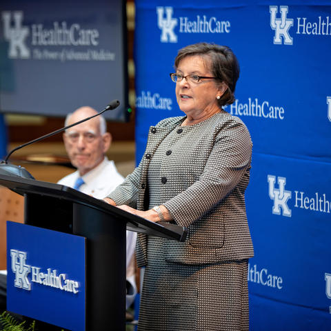Dean Nancy Cox speaks at podium