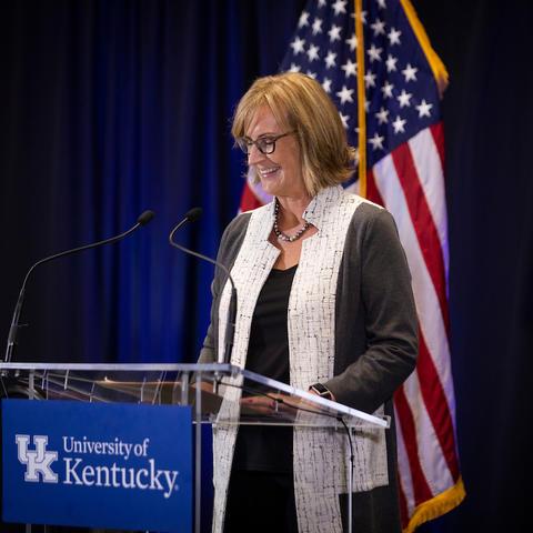 Photo of Sharon Walsh at the podium