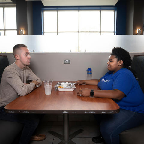 photo of two students eating together