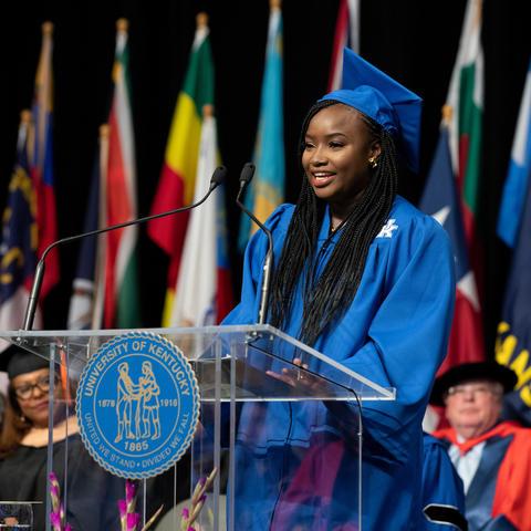 Graduate speaking at podium