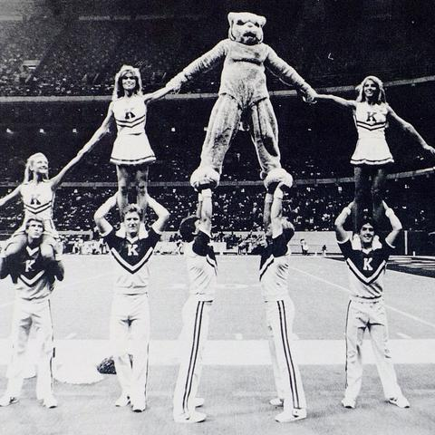 black and white photo of UK Cheerleaders in pyramid from 1985 Kentuckian