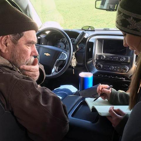 Richard Preston and Hanna Poffenbarger seated in vehicle