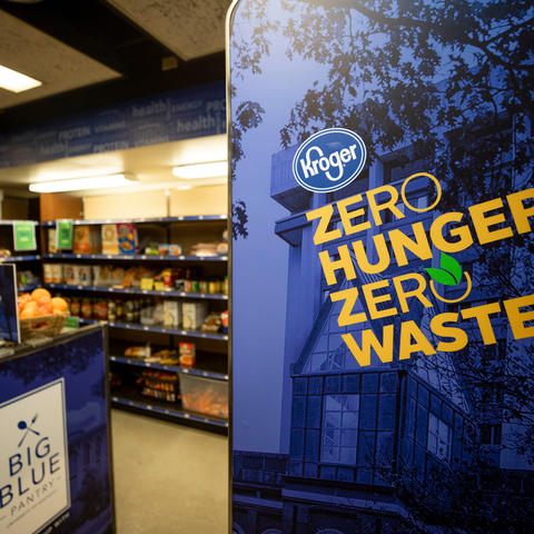 Detail of Big Blue Pantry wall with Kroger logo and writing