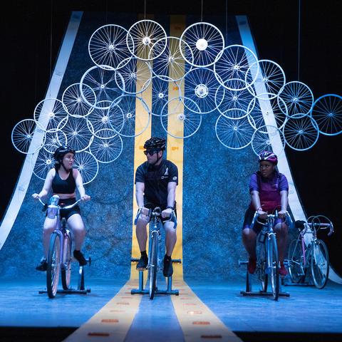"photo of 4 cast members performing in UK Theatre's ""Bike America"""