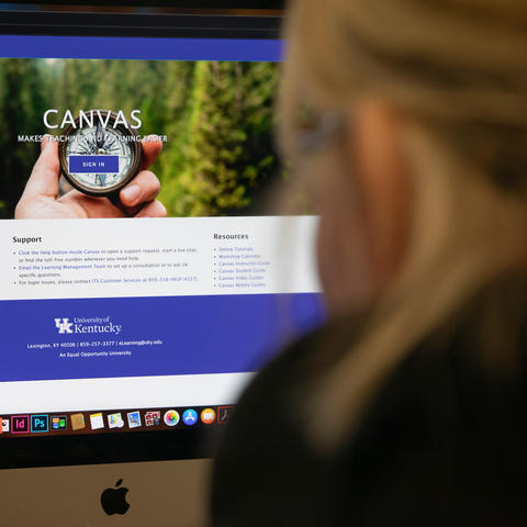 student taking online courses looking at the Canvas web page on their home computer