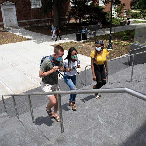 photo of students walking up the outside steps of the Rosenberg College of Law.