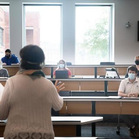 photo of faculty and students in a classroom