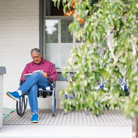 Tom Williams, a UKHC patient, enjoys a fall day on his front porch.