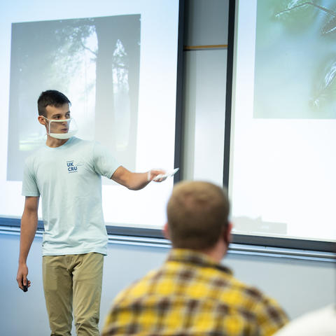 A student presenting in a clear face mask. Photo by Mark Cornelison   UKphoto