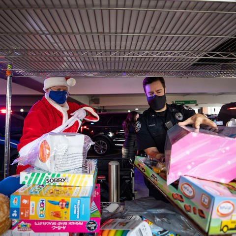 photo of UK Police Chief Joe Monroe dressed as Santa and UK Police Sgt. Wesley Tyler unloading toys for Kentucky Children's Hospital patients.