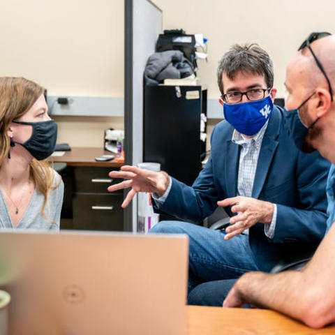 Photo of Dr. Alexandre Martin and Team of Researchers Having a Discussion