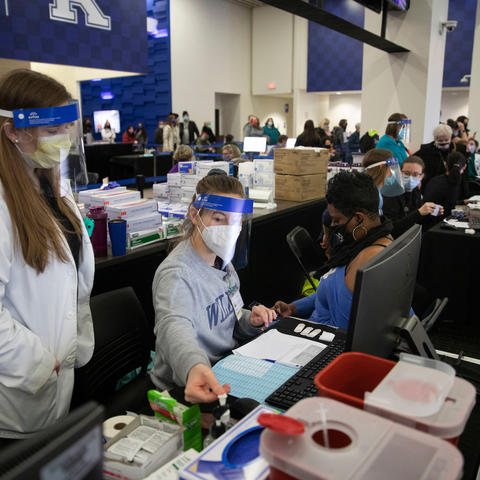 Photo of volunteers working at COVID-19 vaccine clinic at Kroger Field