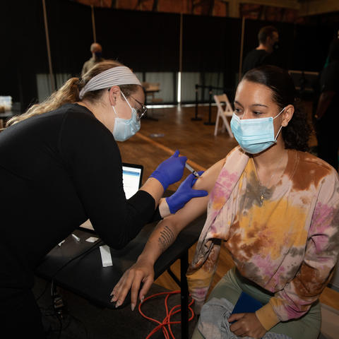 Photo of student getting vaccinated for COVID-19 in the Blue Box Theater