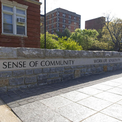 """Wall in plaza in front of Memorial Hall with """"A Sense of Community"""" etched into it"""